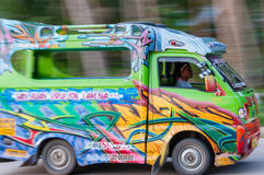 FIlipino Man Driving a Very Colorful Jeepney mini Stock Images