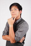 Filipino man with hand on chin Stock Photo