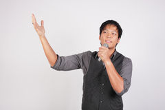Filipino man singing and smiling Royalty Free Stock Photo