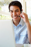 Filipino man using skype Stock Photos