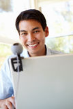 Filipino man using skype Royalty Free Stock Photography