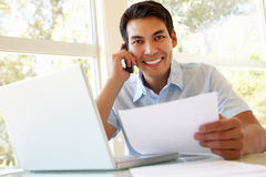 Filipino man working at home Royalty Free Stock Photos
