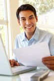 Filipino man working at home Stock Image
