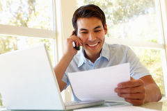 Filipino man working at home Royalty Free Stock Photo