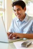 Filipino man working on laptop Stock Photography