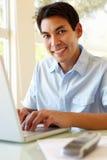 Filipino man working on laptop Royalty Free Stock Photo