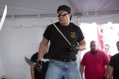 Filipino Martial Arts Demo. LOS ANGELES - APRIL 5:  Members of Lameco Eskrima International demonstrate Filipino Martial Arts (machete fighting) at the Little Stock Image