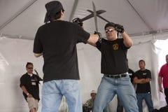 Filipino Martial Arts Demo. LOS ANGELES - APRIL 5:  Members of Lameco Eskrima International demonstrate Filipino Martial Arts (machete fighting) at the Little Royalty Free Stock Photo