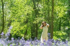 Filipino model in a blue bell wood Royalty Free Stock Images