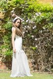 Filipino model in front of a house in the countryside at springtime Royalty Free Stock Photography