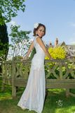 Filipino model in front of a house in a garden at springtime Stock Image