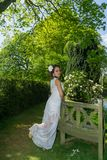 Filipino model in front of a house in a garden at springtime Stock Photo