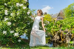 Filipino model in front of a house in a garden at springtime Royalty Free Stock Photos