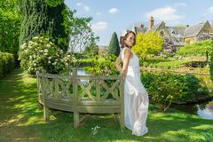 Filipino model in front of a house in a garden at springtime Royalty Free Stock Images
