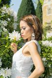Filipino model in front of a house in a garden at springtime Royalty Free Stock Photo
