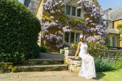 Filipino model in front of a house in a garden at springtime Stock Photography