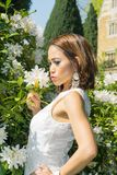 Filipino model in front of a house in a garden at springtime Royalty Free Stock Image