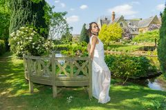 Filipino model in front of a house in a garden at springtime Stock Images