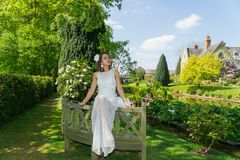 Filipino model in front of a house in a garden at springtime Royalty Free Stock Photography