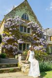 Filipino model in front of a house in a garden at springtime Stock Photos