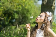 Filipino model in a rapeseed field in the springtime Stock Image