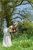Filipino model in a rapeseed field in the springtime Royalty Free Stock Images
