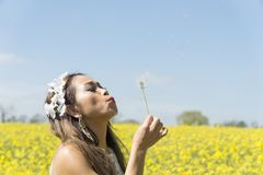 Filipino model in a rapeseed field in the springtime Royalty Free Stock Image