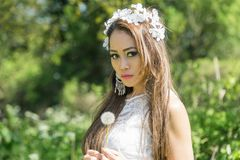 Filipino model in a rapeseed field in the springtime Royalty Free Stock Photo