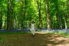 Filipino model running through a blue bell wood Stock Photography