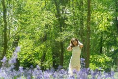 Filipino model running through a blue bell wood Royalty Free Stock Photos