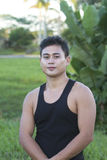 Filipino model. Young male handsome filipino brown skin model outdoor background Stock Image