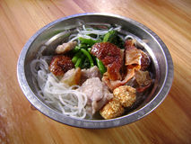 Filipino noodles convenient food. With Chinese baked duck, taro, salted pork, vegetable Royalty Free Stock Photos
