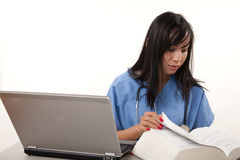 Filipino nurse doctor working on laptop Stock Photography