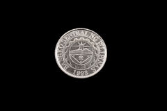Filipino one piso coin close up on black. An extreme close up of an Filipino one piso coin on a solid black background Royalty Free Stock Images