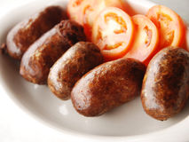 Filipino Sausage. Meal on a White Plate Royalty Free Stock Photography