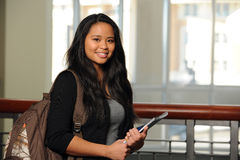 Filipino Student. Portrait of Filipino girl with notebook and backpack indoors Royalty Free Stock Photos