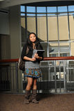 Filipino Student. Young Filipino student holding notebook indoors Royalty Free Stock Image