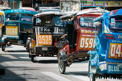 Filipino Tricycles Caught Up In a Traffic Royalty Free Stock Image