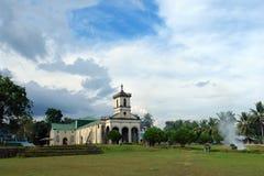 Filipino village church. Rural exotic Filipino village church and common parish lawn near sunset after a tropical rainstorm stock photography