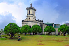 Filipino village scene with church. Royalty Free Stock Photos