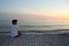 Filipino Woman at Agawa Bay During Sunset. Filipino woman on the beach during sunset. Lake Superior Provincial Park, Ontario Stock Photo
