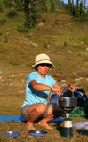 Filipino Woman Cooking on Campstove Stock Images