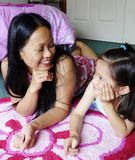 Filipino Woman And Her Daughter Chatting. Stock Image