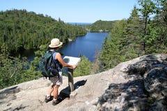 Filipino Woman Hiking at Orphan Lake. Filipino woman hiking above Orphan Lake. Lake Superior Provincial Park, Ontario stock photos