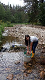 Filipino Woman Panning For Gold Stock Image