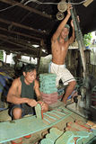 Filipino workers working in flipflop factory Stock Photo