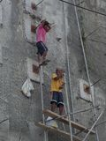 Filipino workmen on scaffolding rig. No health and saftey. Royalty Free Stock Images