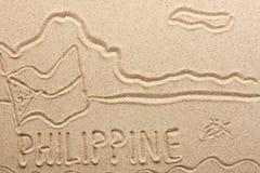 Filippinerna som är handskriven från sand royaltyfri foto