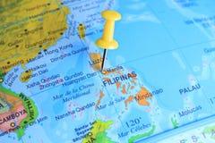 Filippinerna som klämmas fast på en översikt av Asien arkivfoto