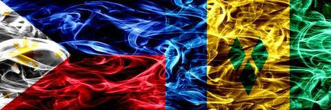 Filippinerna vs Saint Vincent och Grenadinerna rökflaggor förlade sidan - vid - sidan Tjocka abstrakta kulöra silkeslena rökflagg vektor illustrationer
